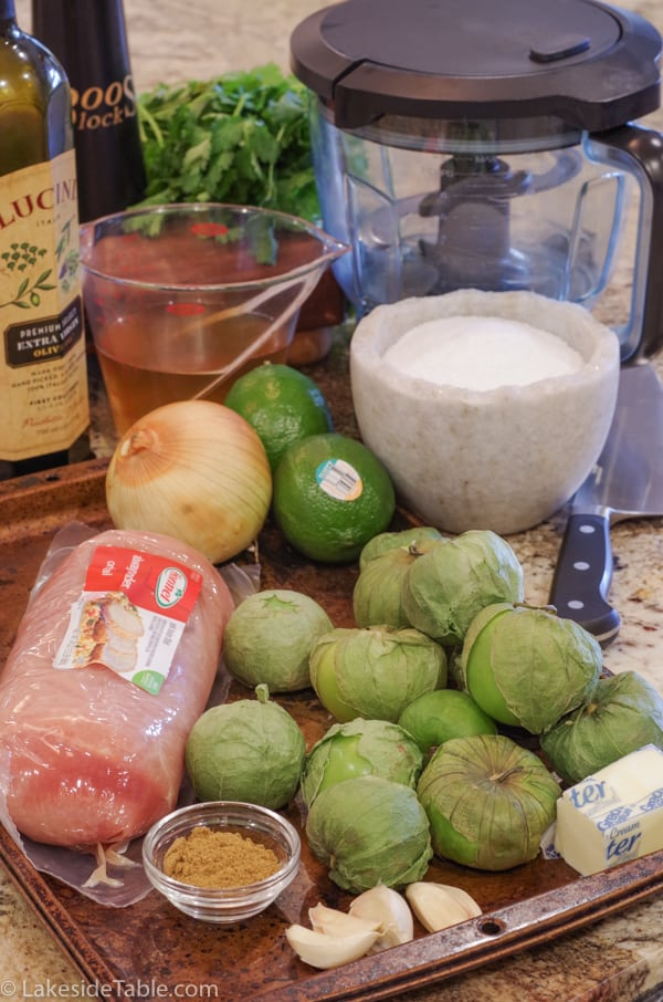 Ingredients: tomatillos, pork, lime, cilantro, chicken broth, olive oil, salt, onion, cumin and garlic