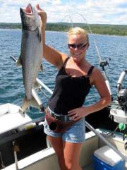 Lake superior trout held by woman angler