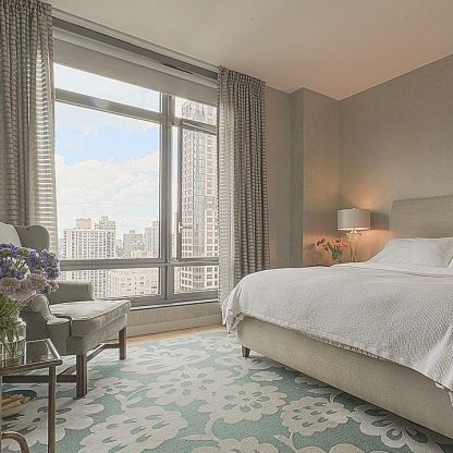The cool tones of this bedroom escape the summer heat, but not the view! #cooltones #uptownviews #summerinthecity #nycinteriordesign #escapetheheat