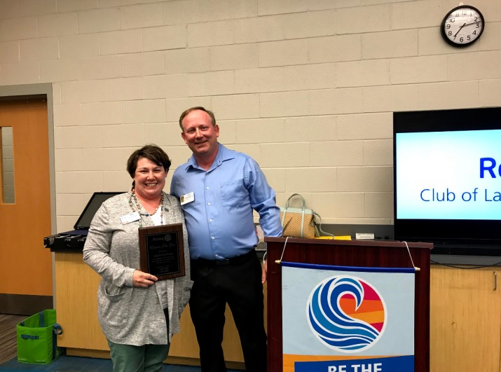 2019 Rotarian of the Year Amy Strong with Award Presenter Chad Bordeaux