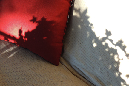 red pillow in the sun and shadow
