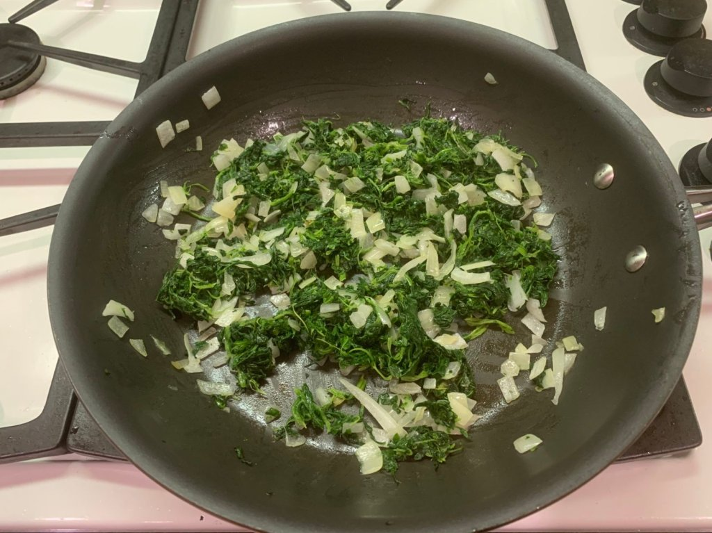 Spinach and onions cooking