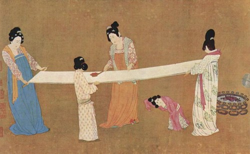 Ancient Chinese court ladies inspecting silk fabric