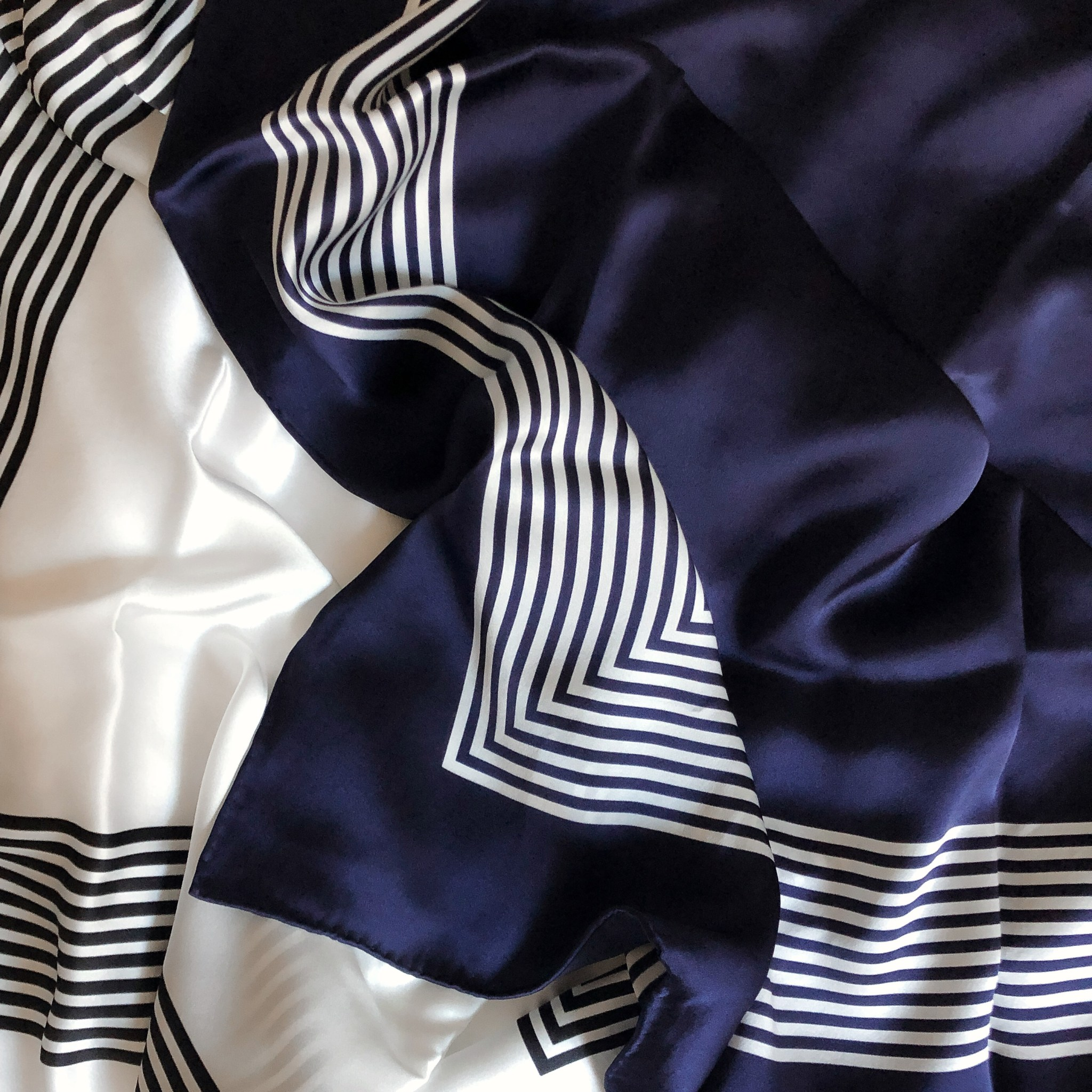 Lalouette navy and white square silk scarves closeup