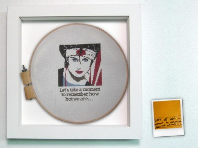 "Cross stitch in shadowbox with graffiti polaroid 16"" x 16"" x 2"" $375.00"