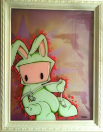 "Acrylic on plexi, aerosol on canvas 18"" x 24"" in 20"" x 26"" frame $600.00"