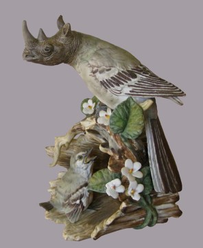Click Mort - Rhino-headed Harpy Ignoring Baby Bird