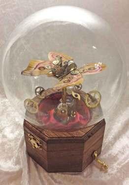 6 x 9 x 6 in. Mechanical sculpture of clockwork, real moth, garnet & alexandrite gemstones $650.00 Sold