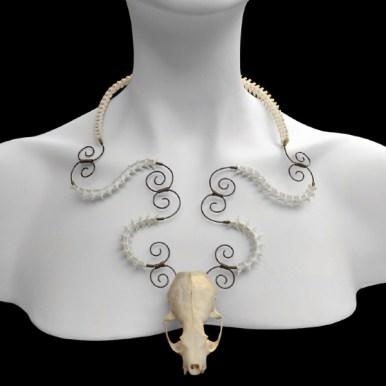 Mink skull, Texas concho & California king snake vertebrae, brass wire, 18 x 4 x 6 in. $750.00
