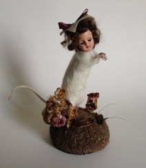 Taxidermy rat, found doll's head, preserved cockroach and cricket, millinery flowers, dirt, and foam, 8 x 7 x 4 in. $350.00