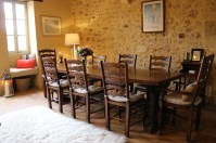 Eight chairs at dining table