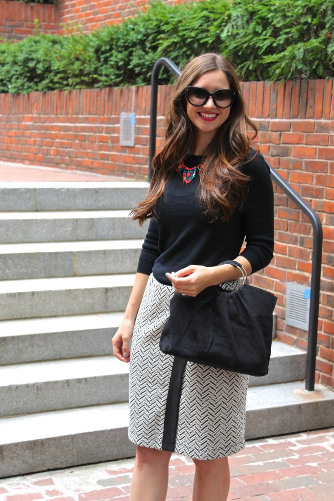 Asymmetrical houndstooth print skirt and pink patent leather flats