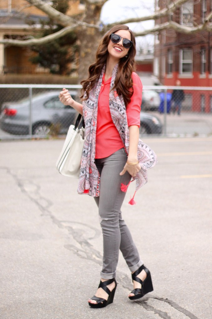 Neon Coral Blouse with Ripped Grey Jeans and Black/White Colorblock Accessories