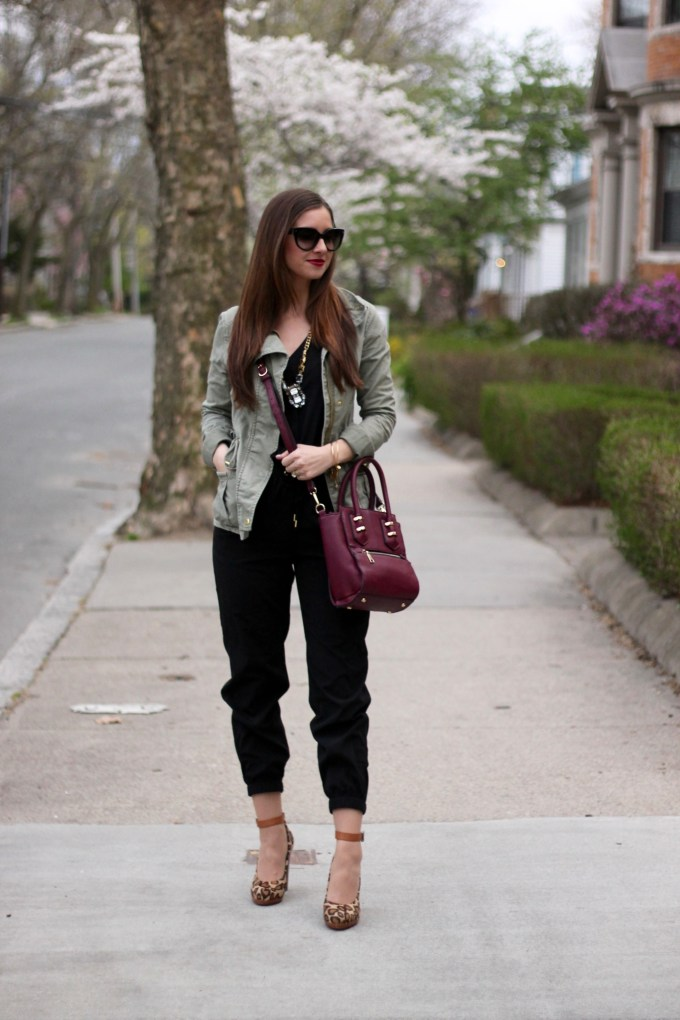 Casual Black Jumpsuit, Green Anorak Jacket and Chunky Leopard Heels