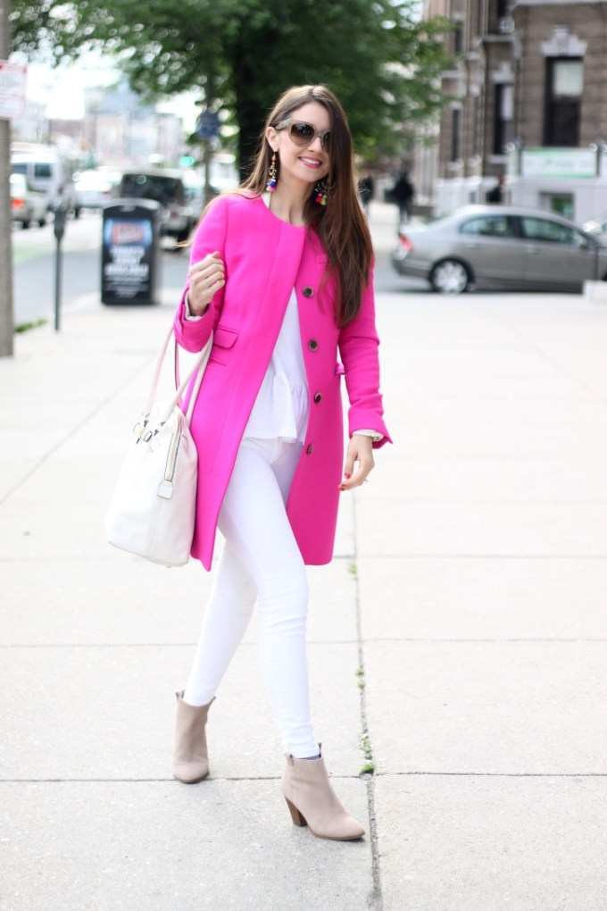 Neon Pink Coat with All-White and Oversized Rainbow Tassel Earrings