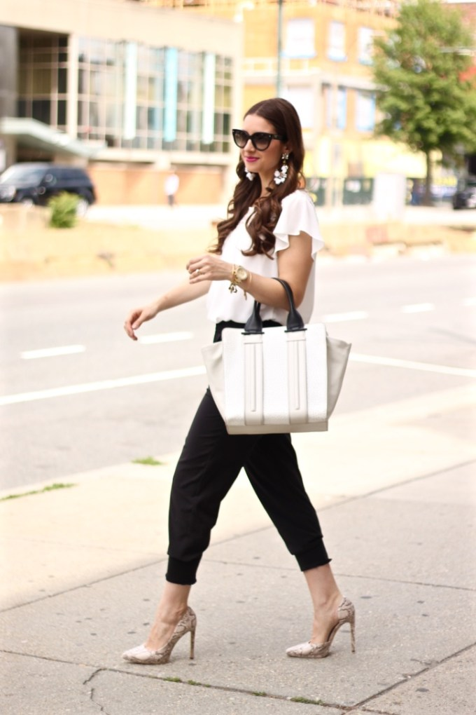 Black joggers, White Blouse, colorblock bag, and snakeskin heels