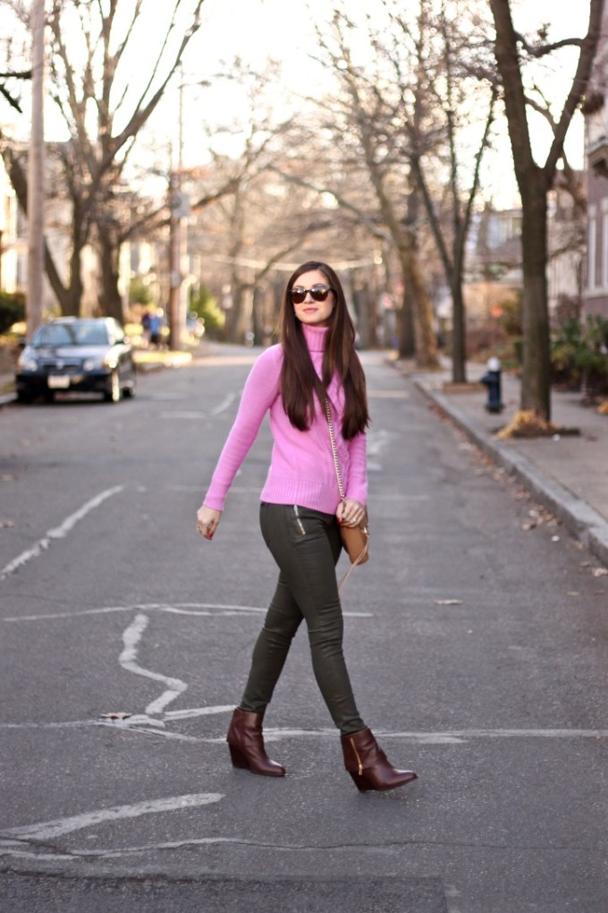 J.Crew Bright Orchid Pink Cambridge Cable turtleneck sweater, Joe's Coated Olive Rollin Zip Pocket Skinny Jeans