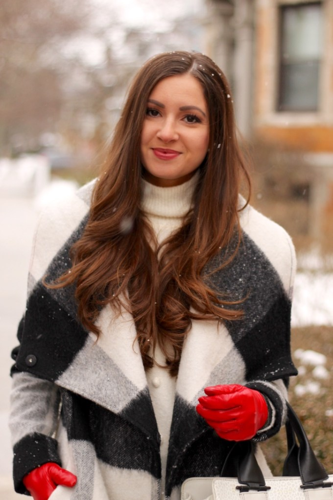 Chic Winter Outfit: Black and white checkered coat, red leather gloves