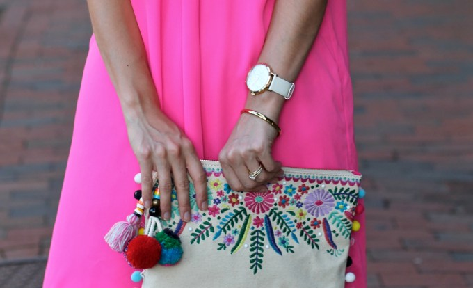 Off the shoulder hot pink ruffled dress, embroidered clutch with pom poms