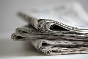 bigstock-Newspapers-folded-and-stacked--43156909