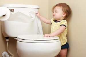 self-control Baby pulling toilet paper off the roll