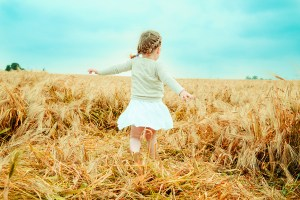 let it go - dancing child nostalgic in field