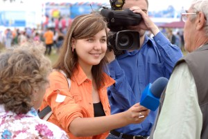 say -Smiling Female Tv Reporter
