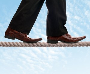 trust - Businessman on a tightrope concept for risk, balance, leadership