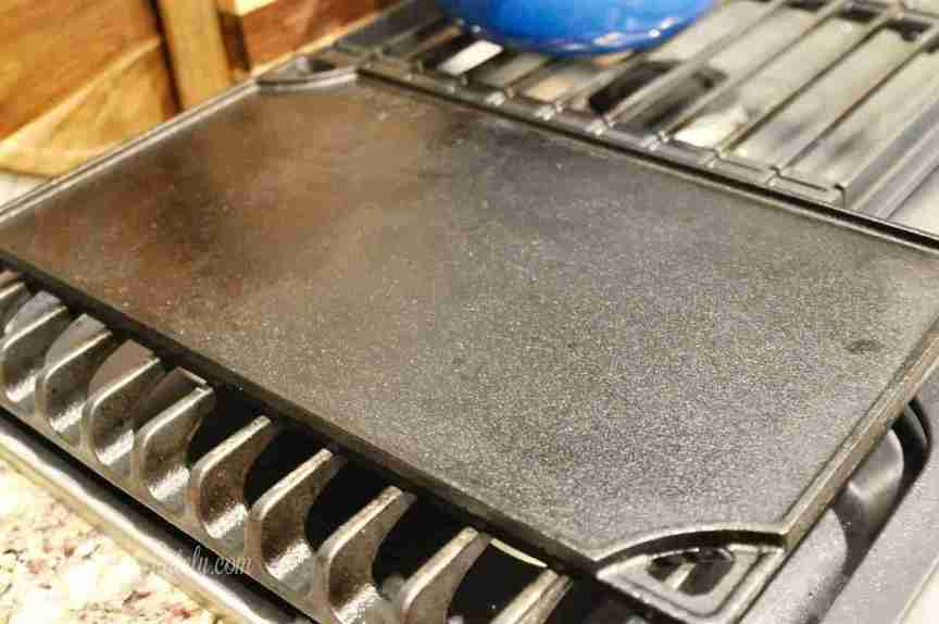 This post shows how to clean cast iron the easy way, using just salt, water, dish soap, and oil. This method is great for griddles, pans, and skillets!