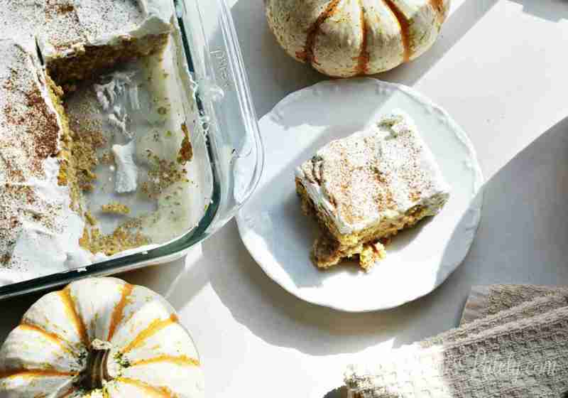 This recipe for Pumpkin Spice Tres Leches Cake is so easy - uses boxed mix, coffee creamer, sweetened condensed milk, and other simply ingredients to make a perfect fall dessert!