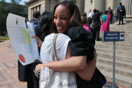 HUGS ALL AROUND: Bronwan Smith hugs her sister after receiving her degree. Photo: Lameez Omarjee