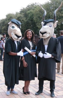 WITSIE FOR LIFE: A graduate takes the opportunity to pose with mascots, Kudos Kudu and his sister. Photo: Lameez Omarjee