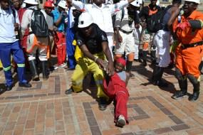 HEAVY LABOUR: A Witsie reenacts mining labour. Photo: Lameez Omarjee