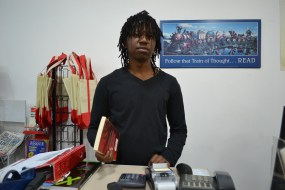 BOOKIE: Student Moshe Mashela juggles his studies with his part-time job at the local bookstore. Photo: Lameez Omarjee