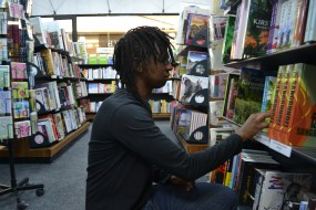 LIGHT READING: When he is not reading up on cases for law, Moshe Mashela is seen at the local bookstore, managing the shelves. Photo: Lameez Omarjee