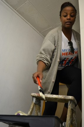 BALANCING ACT: Even though she fears heights, student Moleboheng Mosia had the courage to paint while standing on a ladder. Photo: Lameez Omarjee