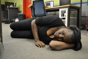 ASLEEP: Mastermind behind the project, masters student Susie Maluleke demonstrates a situation of students sleeping in computer labs, she will hold workshops to create awareness of the problem on campus as part of a project . Photo: Lameez Omarjee