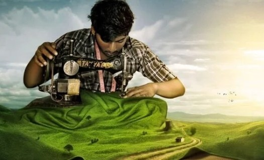 hombre con una máquina de coser construyendo su éxito