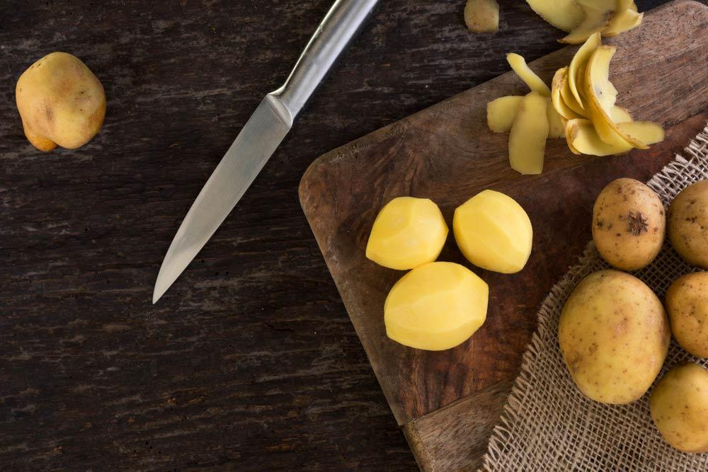 paletilla de cordero lechal al horno con patatas