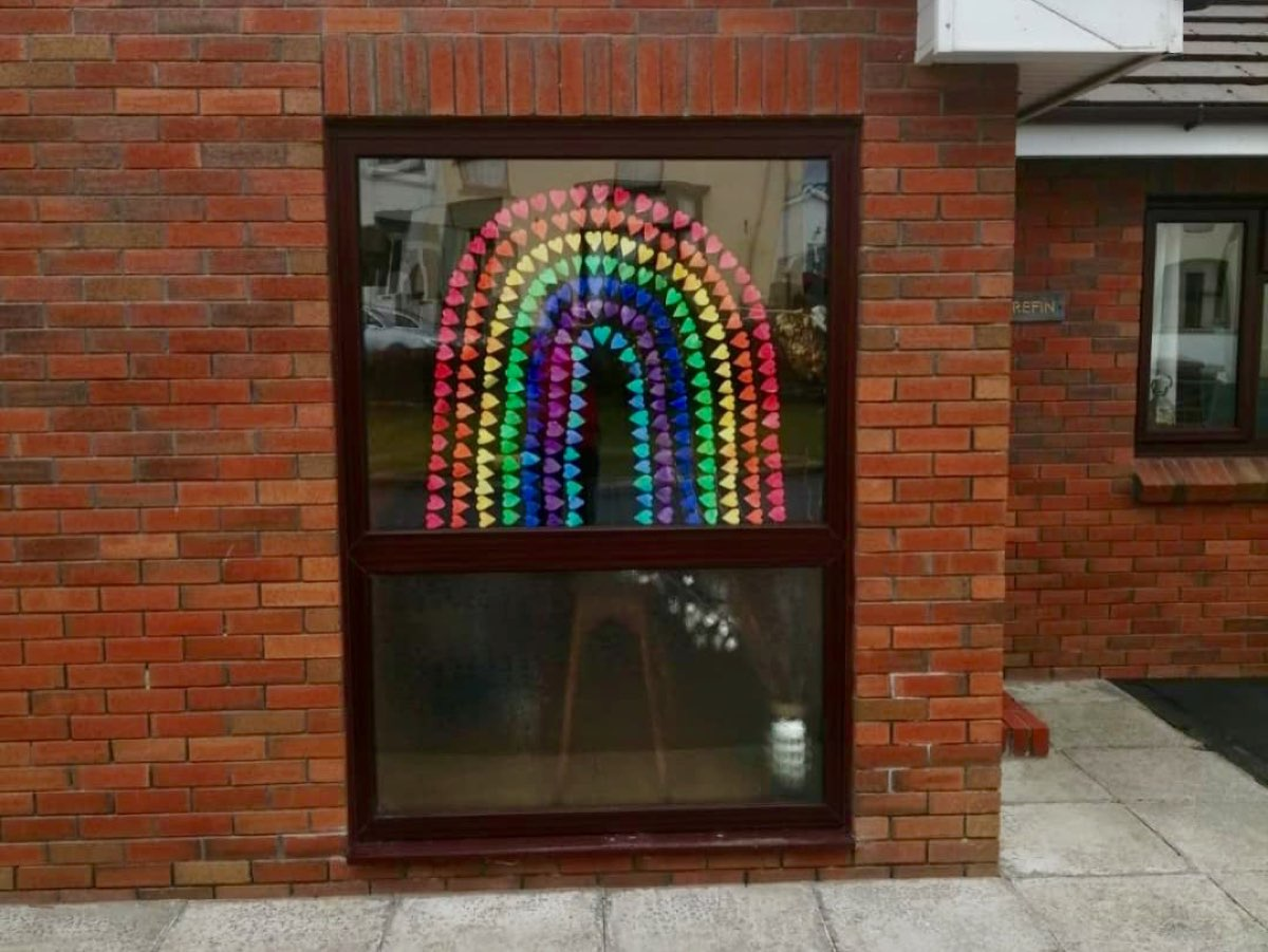 a rainbow made out of coloured heart shapes, it's a big one, filling the entire window