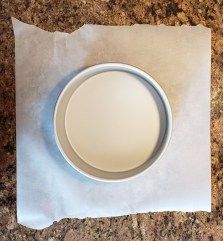 Cut a square piece of parchment paper that is larger than the pan.