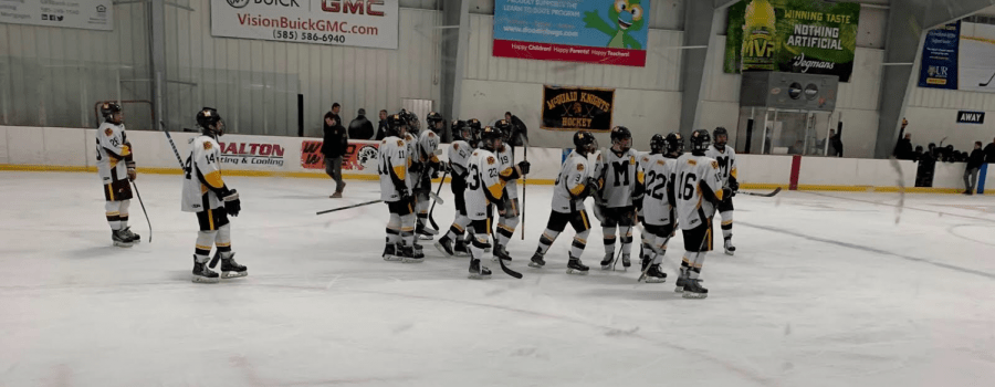 The+Hockey+Knights+celebrate+a+win+after+defeating+Rush-Henrietta+at+Thomas+Creek+arena+Thursday.