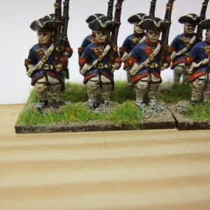 6xMusketeer advancing shouldered musket turnback coat