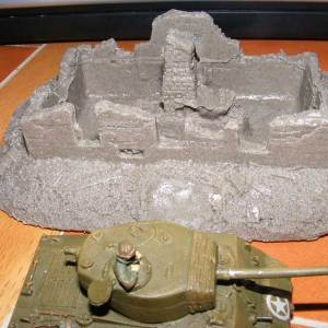 Ruined Russian cottage with internal trench