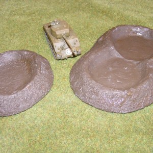 Three times shell holes (one single, one double).