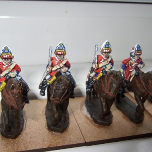 3 Heavy cavalry wearing mitre, sword at shoulder