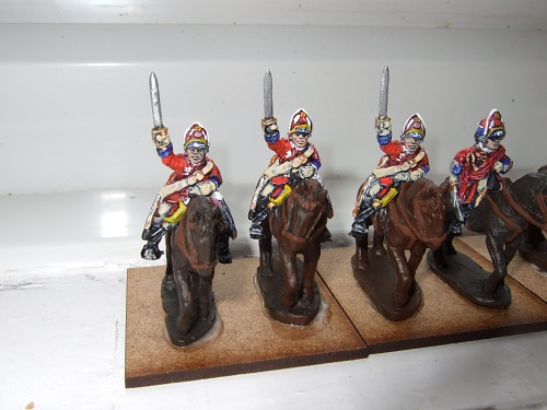 3 Heavy cavalry wearing mitre, waving sword above head