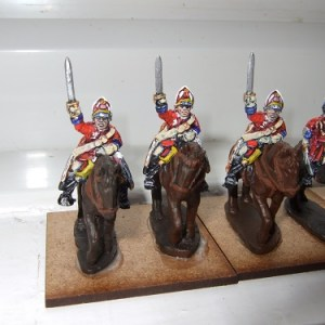 3 Heavy cavalry wearing mitre, waving sword above head