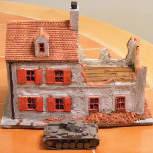 N.W house battle damaged, matches LM23 nicely