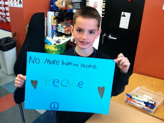 boston marathon terrorist attack kid with sign no more hurting people peace